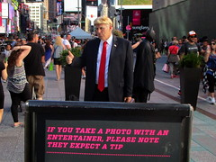 Times Square, NYC, 06/24/17: man dressed as Donald Trump, a new addition to the costumed characters who pose for photos with tourists for tips (IMG_5166a)