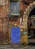 no entry behind the blue brick door