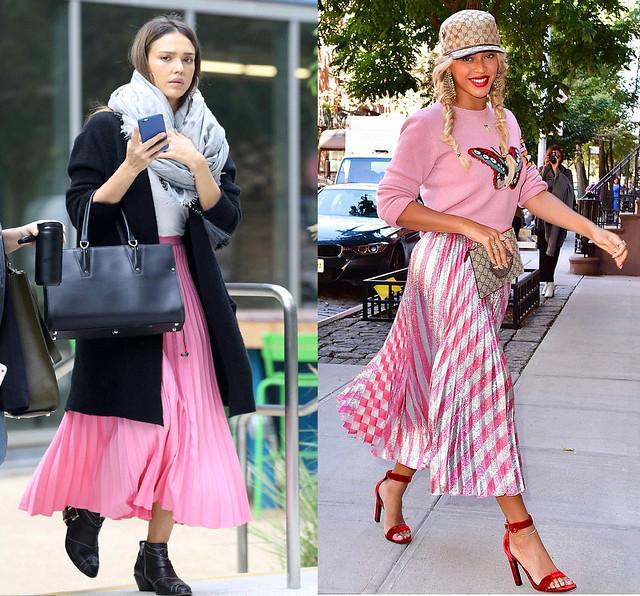 pink accordion midi length skirts, black coat, pink sweater
