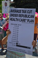 Tax cuts that are part of the Republican backed American Health Care Act (AHCA) were a concern of the woman at a rally in Denver.