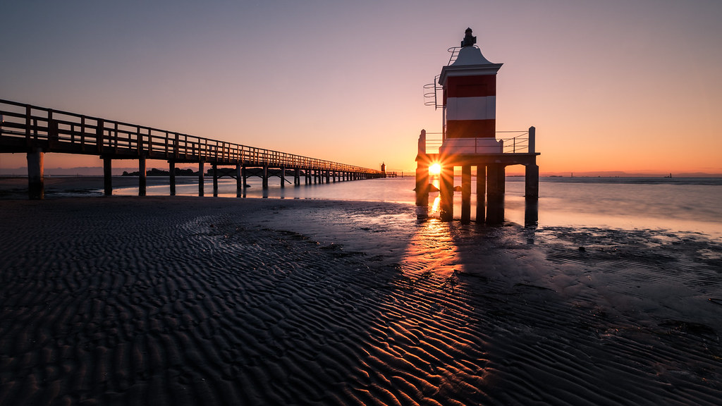 Sunrise at the red lighthouse, Lignano, Italy picture