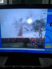 OMG! Look at this guy on the news mowing his lawn with the tornado right behind him. I can just hear his wife in the back round saying honey you missed a spot!  LMAO