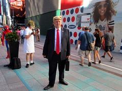Times Square, NYC, 06/24/17: man dressed as Donald Trump, a new addition to the costumed characters who pose for photos with tourists for tips (IMG_5169a)