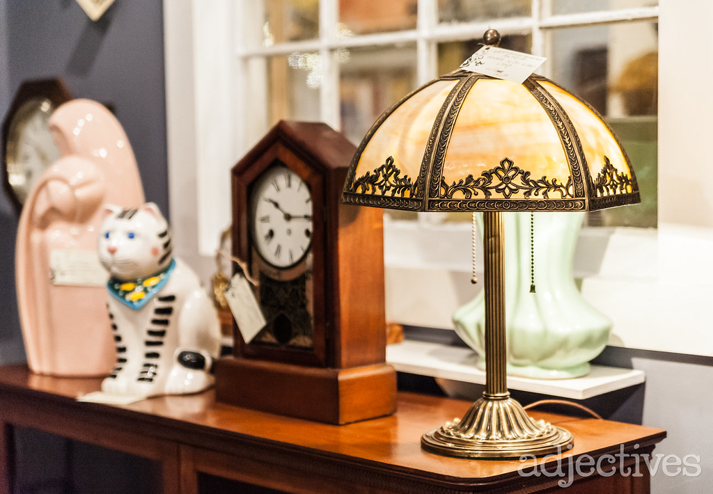 Vintage lamp, clock, statues in Winter Garden by Timeless Treasures