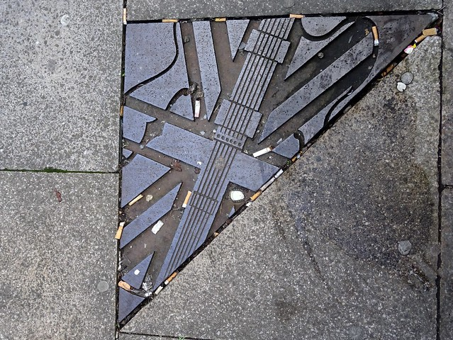 Manchester music pavement art on Oldham Street