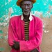 Portrait of an old Hamer tribe man with a yellow hat and a pink jacket, Omo valley, Turmi, Ethiopia by Eric Lafforgue