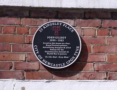 Photo of John Gilroy black plaque