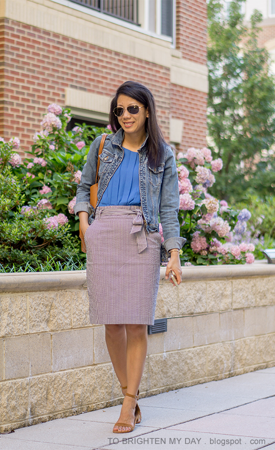 denim jacket, bright blue pleated top, gold jewelry, striped paperbag pencil skirt with bow, brown suede sandals