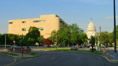 Washington D.C.: Smithsonian National Museum of the American Indian and in the back the United States Capitol