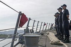 Sailors aboard USS Sterett (DDG 104) man the lines as the ship arrives in Subic Bay, June 18. (U.S. Navy/MC1 Byron C. Linder)