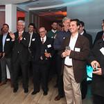 Algunos invitados disfrutando la exposición de Enrique Bone, Presidente de CIS.