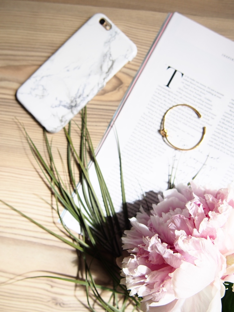 Peony, fashion magazine and marble phone case flatlay