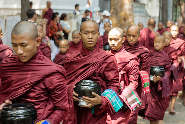 Monks waiting in queue for lunch