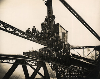 Workers celebrating the completion of the Tyne Bridge arch
