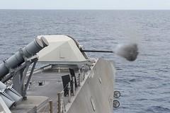 USS Coronado fires a Mark 110 57 mm gun during a live-fire exercise.