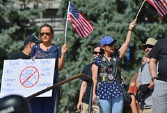 "Supporters of the ""Stop Sharia Law"" rally in Denver display flags and signs."