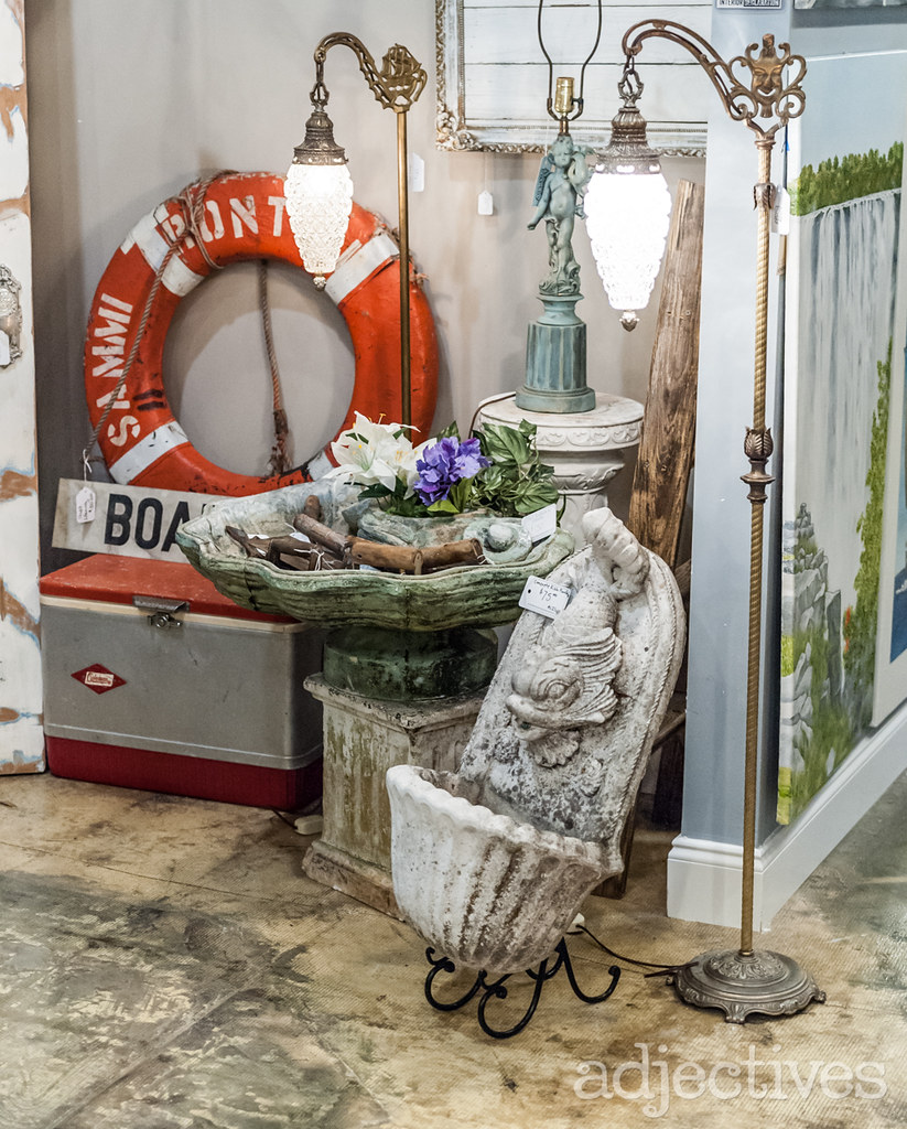 Vintage floor lamps, concrete fish fountain and vintage bird bath by Artsy Fartsy at Adjectives Altamonte