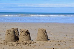 Sandcastles on a beach in Dinas Dinlle