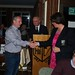 Seamus Fallon being congratulated by Paula Connaughton (President RGC)