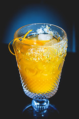 Cocktail with tequila orange juice and salt crusted