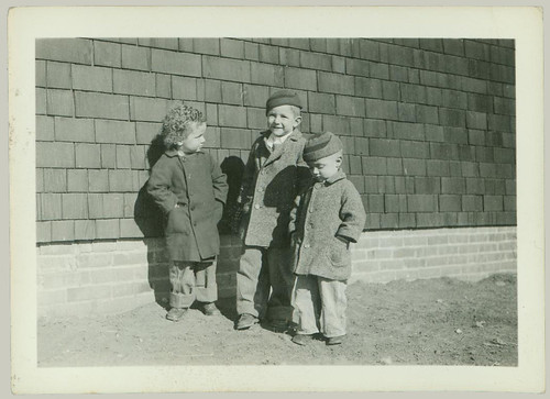 Three children in coats