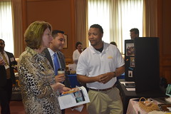 Rep. Green and Rep. Ferguson talk with representatives from Futures Inc. during an Arc Luncheon at the Capitol