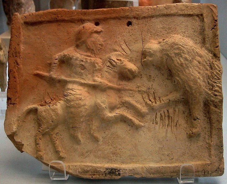A relief depicting a Parthian cataphract fighting against a lion