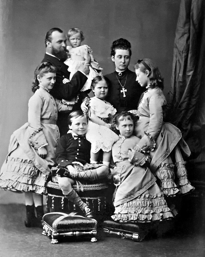 The Hessian family in May 1875 (clockwise from far left)—Ella, Grand Duke Ludwig holding Marie, Alice, Victoria, Irene, Ernie and Alix in the center