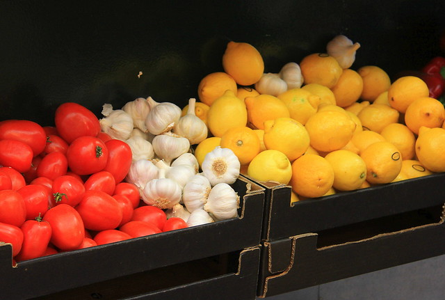 Spanish tomatoes, garlic and lemons on sale at Girona Food Market