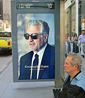 Robert De Niro In bus-stop ad for Ermenegildo Zegna, Italian maker of fine menswear and accessories, 600 block of Fifth Avenue, New York City.
