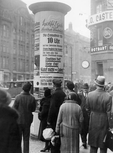 Germans reading street notices about the economic boycott against Jews
