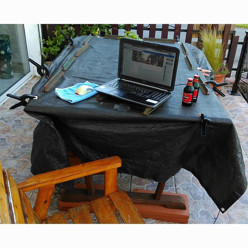 Outdoor office. Can't beat it.   Dining table still has winter cover on.