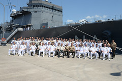 Participants of the U.S.-Japan bilateral amphibious and mine warfare staff talks pose for a group photo in front of JS Bungo (MST 464). (U.S. Navy/LT Adam Cole)