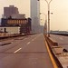 Just another day walking south toward the World Trade Center on the abandoned West Side Highway in Tribeca before there was a Tribeca. The brand new Independance Plaza North to the left of the Twin Towers. New York. June 1974 by wavz13