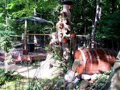 Whiskey barrel waterfall with satellite dish gazebo and treeopolus!