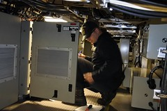 Fire Controlman 1st Class Niklaus Pegler conducts an inspection of the multi-function racks aboard USS Jackson (LCS 6) during Final Contract Trials, May 15. (U.S. Navy/MC1 Christopher J. Bright)