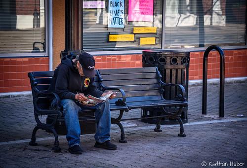 2017 bench courtyard karltonhuber magazine man peoplewatching reading santaana signs sitting southerncalifornia storefronts storewindows streetphotography streetscene urban urbanlandscape