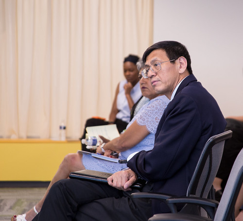Shenggen Fan listens during the question and answer session