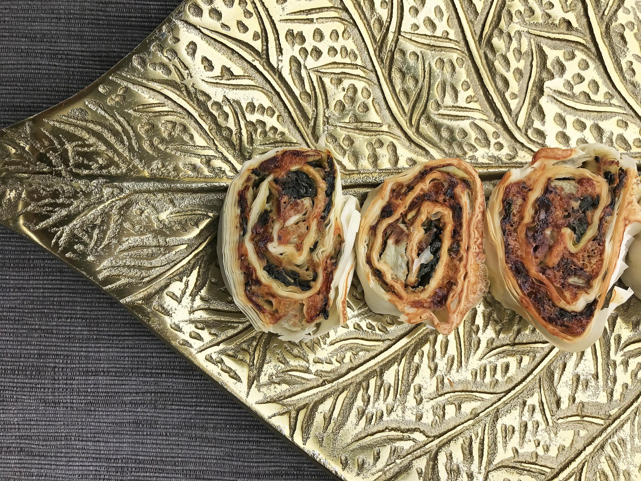 Artichoke and spinach filo rolls