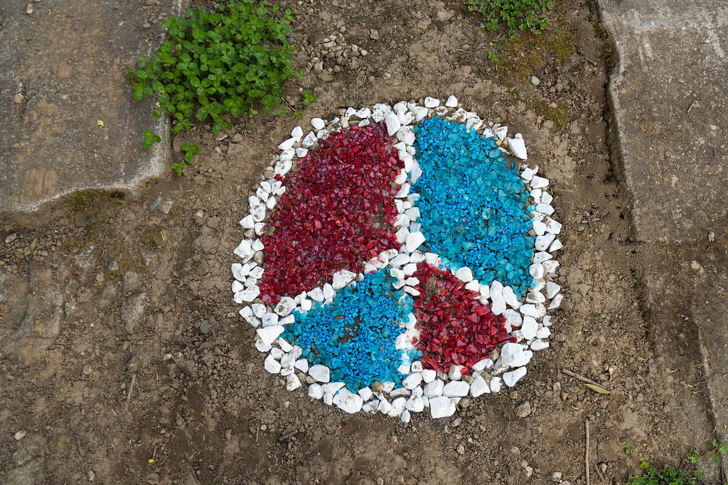 A peace sign made of colored rocks in a driveway in the Irvington neighborhood of Portland, Oregon