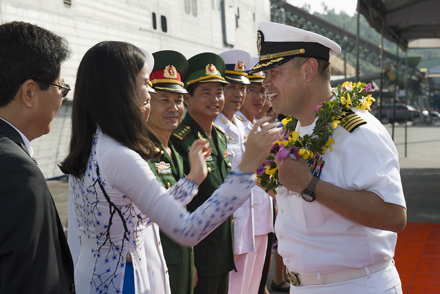 Capt. Stanfield Chien receives a wreath from Da Nang locals.