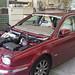 Jaguar en tôlerie pour le changement du pare-brise. Carrosserie inter-union - 53 route de suisse, 1295 Mies Tél.022 755 45 30 - Fax. 022 779 03 28 Site internet: www.interunion.ch