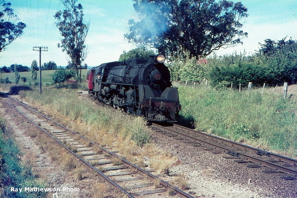 Northbound express approaching Balclutha, legendary Catlins River Branch in the foreground. Late 1960's.