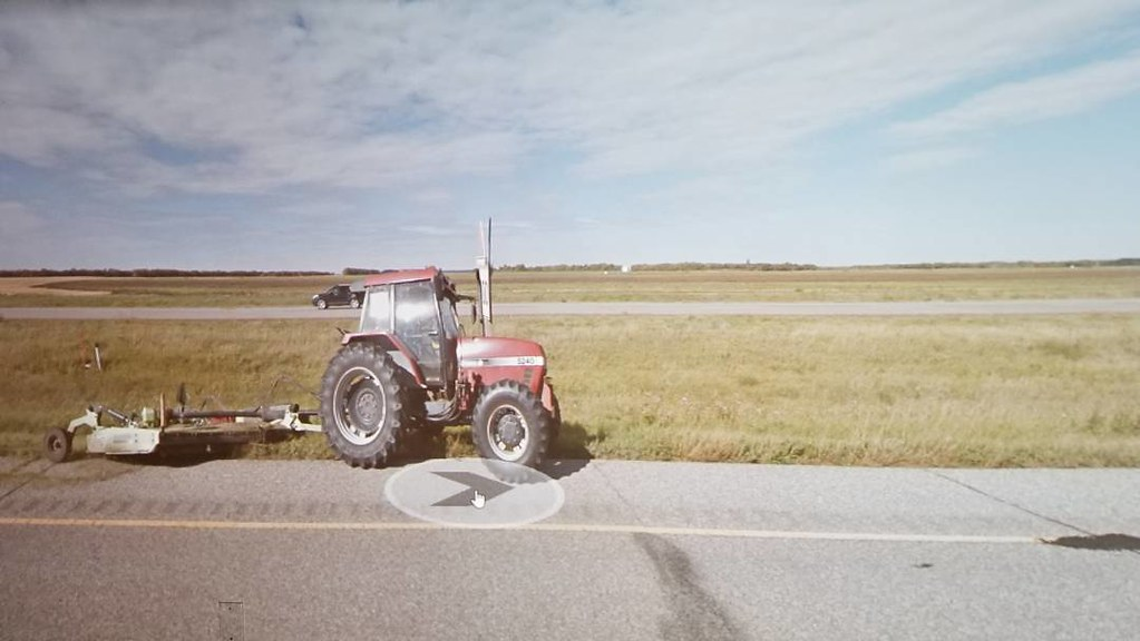 Tractor mowing. Meditative job for some. #ridingthroughwalls #xcanadabikeride #googlestreetview