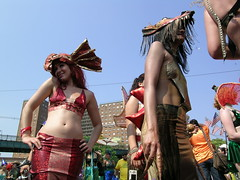 Folks in Red and Gold at the Mermaid Parade in Coney Island