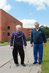 Senior on crutches with family visiting