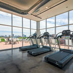 Endless windows and city views is motivation enough to spend time in this rooftop fitness center.