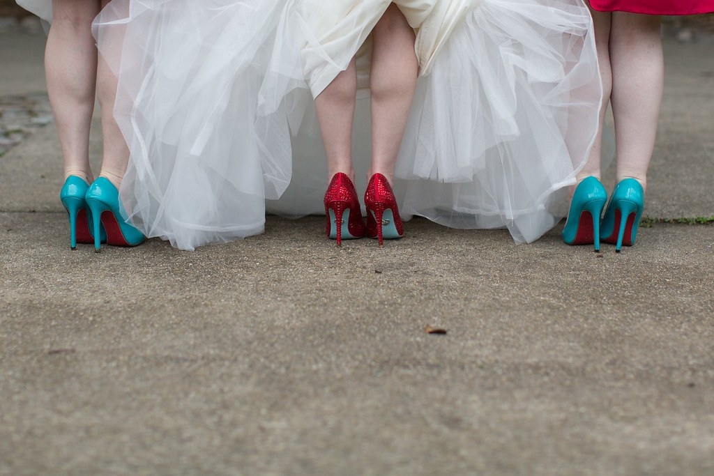 Red and turquoise bride and bridesmaids shoes.