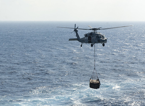 Wed, 06/21/2017 - 08:55 - 170621-N-JC445-110 MEDITERRANEAN SEA (June 21, 2017) An MH-60S Sea Hawk attached to the 'Tridents' of Helicopter Sea Combat Squadron (HSC) 9 carries supplies to the aircraft carrier USS George H.W. Bush (CVN 77) (GHWB) during a replenishment-at-sea (RAS). GHWB, part of the George H.W. Bush Carrier Strike Group (GHWBCSG), is conducting naval operations in the U.S. 6th Fleet area of operations in support of U.S. national security interests in Europe and Africa. (U.S. Navy photo by Mass Communication Specialist 3rd Class Mario Coto/Released)