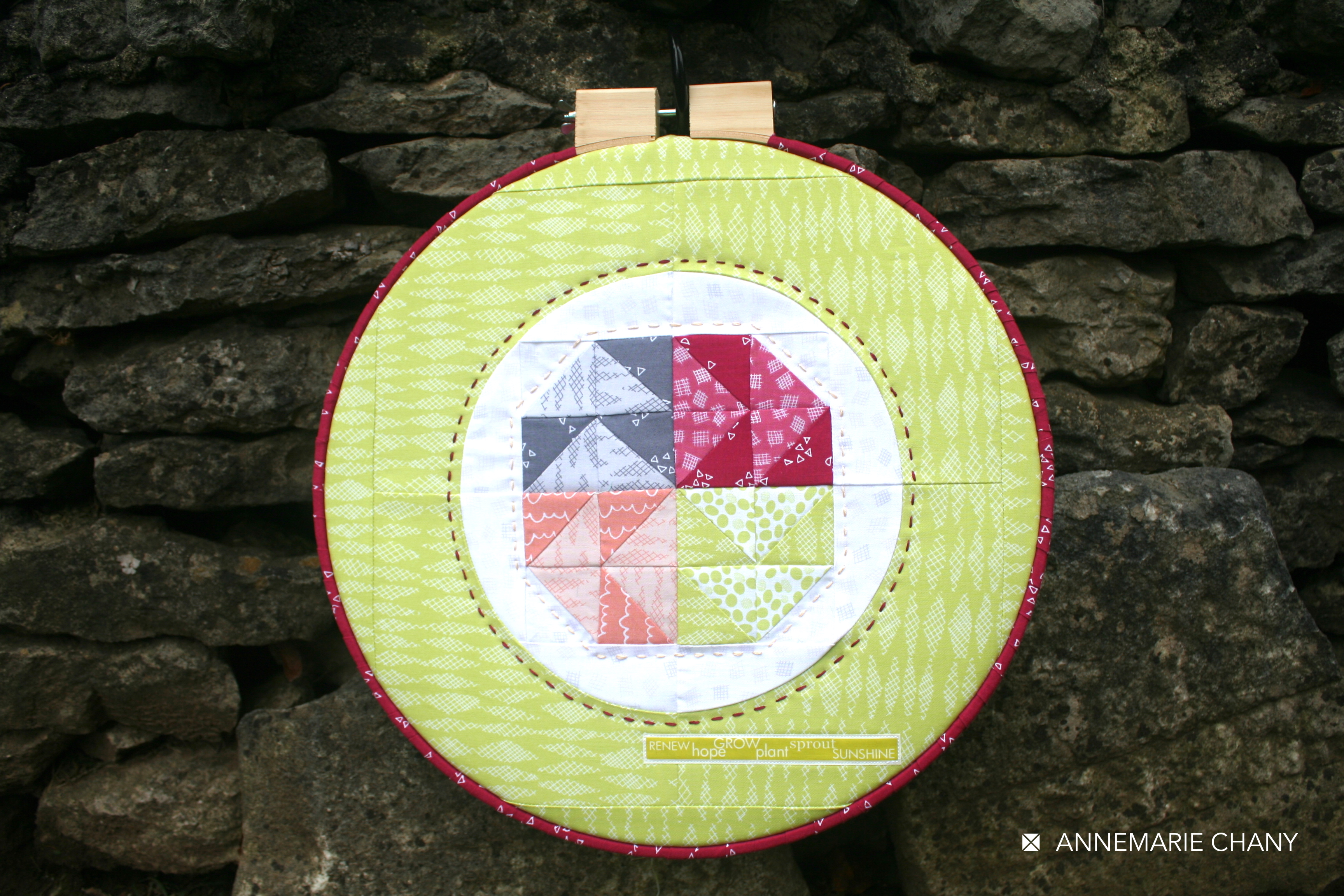 Improv Hoop Quilt on wall by AnneMarie Chany